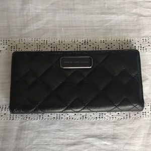 Marc Jacobs black leather quilted wallet.
